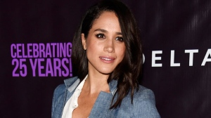 """In this May 20, 2016. file photo, actress Meghan Markle poses at P.S. Arts' """"the pARTy!"""" in Los Angeles. Markle told Vanity Fair for an interview published online on Sept. 5, 2017, that she and Prince Harry are """"two people who are really happy and in love."""" (Photo by Chris Pizzello/Invision/AP, File)"""