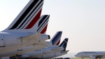 In this Sept.15, 2014 file photo, Air France planes are parked on the tarmac of the Paris Charles de Gaulle airport, in Roissy, near Paris.(AP Photo/Christophe Ena)