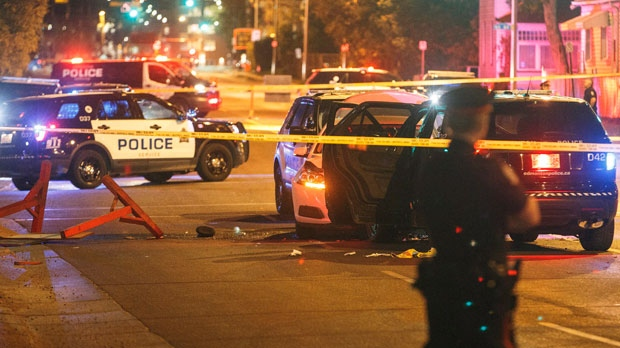 Police investigate the scene where a car crashed into a roadblock in Edmonton Alta, on Saturday September 30, 2017. THE CANADIAN PRESS/Jason Franson
