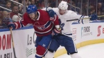 Montreal Canadiens' Jonathan Drouin, left, and Toronto Maple Leafs' Miro Aaltonen battle for the puck along the boards during first period NHL pre-season action Wednesday, September 27, 2017 in Quebec City. The Toronto Maple Leafs moved closer to their opening day roster with a round of cuts Monday. The NHL team trimmed down to 26 by sending 15 players to the AHL Marlies, waiving six others and returning winger Carl Grundstrom back to Sweden. THE CANADIAN PRESS/Jacques Boissinot