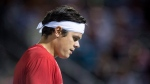 Milos Raonic of Canada reacts during his match against Adrian Mannarino of France during second round of play at the Rogers Cup tennis tournament Wednesday August 9, 2017 in Montreal. THE CANADIAN PRESS/Paul Chiasson