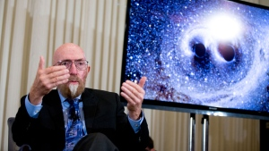 In this file photo dated Thursday, Feb. 11, 2016, Laser Interferometer Gravitational-Wave Observatory (LIGO) Co-Founder Kip Thorne speaks during a news conference at the National Press Club in Washington, USA, to announce that scientists have finally detected gravitational waves. (AP Photo/Andrew Harnik)