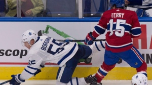 Montreal Canadiens' Chris Terry checks Toronto Maple Leafs' Andreas Borgman, left, during second period NHL pre-season action Wednesday, September 27, 2017 in Quebec City. THE CANADIAN PRESS/Jacques Boissinot