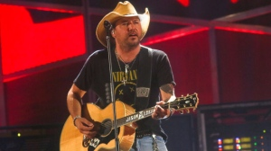 Jason Aldean performs at the iHeartCountry Festival at the Frank Erwin Center on Saturday, May 6, 2017, in Austin, Texas. (Photo by Jack Plunkett/Invision/AP)