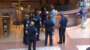 D!ONNE Renée is shown speaking with police inside TPS headquarters on College Street on Sept. 21. Renée is alleging that she was assaulted by an officer while attempting to access an elevator.