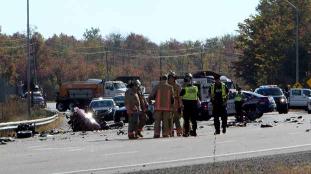 Police and firefighters are seen after a crash that killed a man and woman in Freelton, Ont. on Oct. 5. (Andrew Collins)