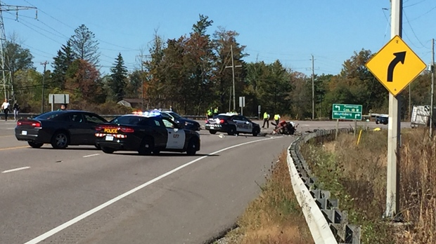 Police cruisers are seen on Highway 6 after two people were killed in a fiery crash on Oct. 5, 2017. (Nick Dixon/CP24)
