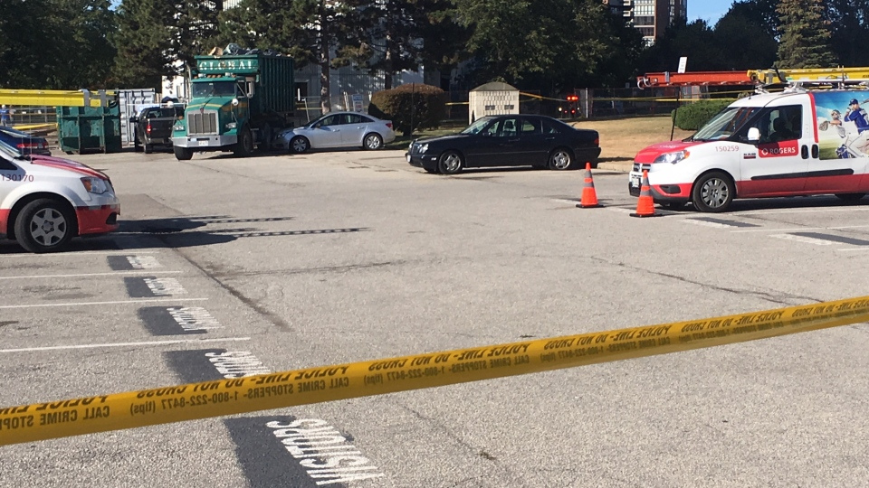 Police tape is shown at the scene of a shooting at an apartment building on Dixon Road west of Islington Avenue on Thursday. (Travis Dhanraj)