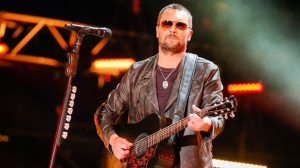 "In this June 10, 2016 file photo, Eric Church performs at the CMA Music Festival at Nissan Stadium in Nashville, Tenn. Country star Church struggled to hold back tears in a tribute to the victims of the mass shooting at a country music festival in Las Vegas and debuted a song he wrote in their honor called ""Why Not Me."" Church was a headliner at the Route 91 Harvest Festival two days before a gunman opened fire on a crowd of thousands Sunday night, Oct. 1, 2017. (Photo by Al Wagner/Invision/AP, File)"