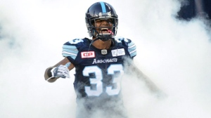 Toronto Argonauts defensive back Alden Darby (33) is covered by artificial smoke prior to CFL football action against the Montreal Alouettes in Toronto on Saturday, Sept. 23, 2017. THE CANADIAN PRESS/Jon Blacker