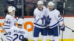 Toronto Maple Leafs' Morgan Rielly (44), William Nylander (29), Patrick Marleau (12) and Nazem Kadri (43) celebrate Marleau's second goal of the game during third period NHL action against the Winnipeg Jets in Winnipeg on Wednesday, October 4, 2017. THE CANADIAN PRESS/John Woods