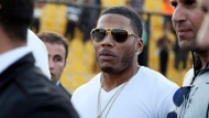 In March 13, 2015, file photo, rapper Nelly approaches the stage for a concert in Irbil, northern Iraq. Police have arrested Nelly after a woman said he raped her in a town outside Seattle, an accusation the Grammy winner's attorney staunchly denies. Auburn police spokesman Commander Steve Stocker said officers arrested Nelly early Saturday, Oct. 7, 2017, morning in his tour bus at a Walmart.  (AP Photo/Seivan M. Salim, File)