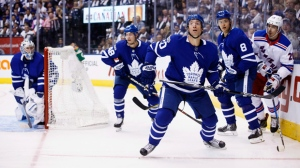 Toronto Maple Leafs centre Dominic Moore (20) looks up at an airborne puck during first period NHL hockey action in Toronto on Saturday, October 7, 2017. THE CANADIAN PRESS/Cole Burston