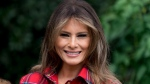 In this Sept. 22, 2017, file photo, first lady Melania Trump smiles during an event in the White House Kitchen Garden on the South Lawn of the White House in Washington. Melania Trump appears to becoming more at ease with her role as first lady. She is beginning to speak out more about how she envisions using her platform to help children in ways beyond cyberbullying. (AP Photo/Andrew Harnik)