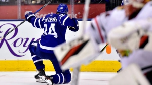 Toronto Maple Leafs centre Auston Matthews (34) celebrates his game-winning goal during overtime NHL hockey action against the Chicago Blackhawks, in Toronto on Monday, October 9, 2017. THE CANADIAN PRESS/Frank Gunn