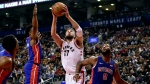Toronto Raptors centre Jonas Valanciunas (17) drives to the net as Detroit Pistons forward Stanley Johnson (7) and Detroit Pistons centre Andre Drummond (0) attempt to defend during first half NBA basketball action in Toronto on Tuesday, October 10, 2017. THE CANADIAN PRESS/Frank Gunn