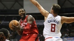 Toronto Raptors forward CJ Miles (0) goes towards the basket as Los Angeles Clippers forward Danilo Gallinari (8) tries to guard him during the third quarter of a preseason NBA basketball game, Sunday, Oct. 1, 2017, in Honolulu. (AP Photo/Marco Garcia)