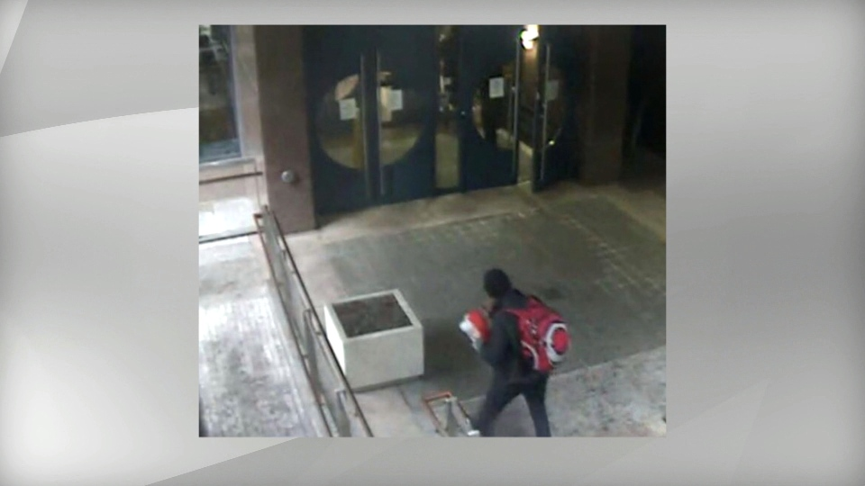 This surveillance camera image shows a suspect who police say left a suspicious package outside their headquarters on College Street. (Toronto Police Service)