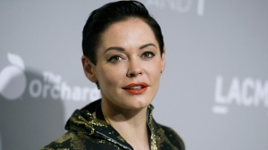 "In this April 15, 2015 file photo, Rose McGowan arrives at the LA Premiere Of ""DIOR & I"" held at the Leo S. Bing Theatre on Wednesday, April 15, 2015, in Los Angeles.  McGowan's Twitter account has been suspended, temporarily muting a central figure in the allegations against Harvey Weinstein. McGowan said late Wednesday, Oct. 11, 2017,  that Twitter had suspended her from tweeting after the social media company said she broke its rules.(Photo by Richard Shotwell/Invision/AP)"