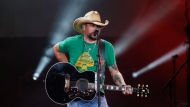 Country star Jason Aldean performs in Tulsa, Okla., Thursday, Oct. 12, 2017. Aldean returned to the stage Thursday after cancelling tour dates following the Las Vegas shooting. (AP Photo/Sue Ogrocki)