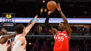 Toronto Raptors guard Delon Wright (55) shoots past Chicago Bulls forward Bobby Portis, left, and guard Ryan Arcidiacono, center, during the first half of an NBA preseason basketball game, Oct. 13, 2017, in Chicago. (AP / Matt Marton)