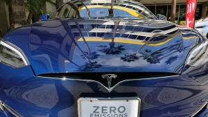 This Oct. 24, 2016, file photo shows Tesla Model S on display in downtown Los Angeles. (AP Photo/Richard Vogel, File)