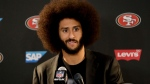 This Dec. 24, 2016 photo shows San Francisco 49ers quarterback Colin Kaepernick talking during a news conference after an NFL football game against the Los Angeles Rams. (AP Photo/Rick Scuteri)