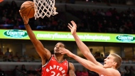 Toronto Raptors guard Norman Powell (24) shoots past Chicago Bulls forward Lauri Markkanen, right, during the first half of an NBA preseason basketball game Friday, Oct. 13, 2017, in Chicago. (AP Photo/Matt Marton)