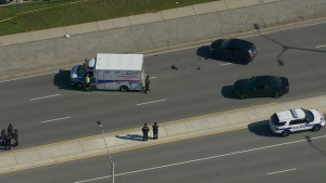 Police and an ambulance are seen on Dixie Road after a fail to remain collision that seriously injured a man on Oct. 17, 2017. (Chopper 24)