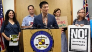 In this June 30, 2017 file photo, Hawaii Attorney General Douglas Chin speaks at a news conference in Honolulu about President Donald Donald Trump's travel ban. On Tuesday, Oct. 17, 2017 a federal judge in Hawaii blocked the Trump administration from enforcing its latest travel ban, just hours before it was set to take effect. U.S. District Judge Derrick Watson granted Hawaii's request to temporarily block the policy from taking effect Wednesday. (AP Photo/Caleb Jones, File)