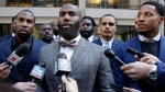 Former NFL football player Anquan Boldin, left, Philadelphia Eagles Malcolm Jenkins, center, and San Francisco 49ers Eric Reid, right, speak to the press outside the league's headquarters after meetings, Tuesday, Oct. 17, 2017, in New York. (AP Photo/Richard Drew)
