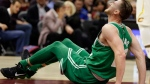 Boston Celtics' Gordon Hayward grimaces in pain in the first half of an NBA basketball game against the Cleveland Cavaliers, Tuesday, Oct. 17, 2017, in Cleveland. Hayward breaking his left ankle on a play. (AP Photo/Tony Dejak)