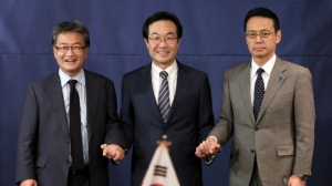 U.S. State Department's Special Representative for North Korea Policy Joseph Yun, left, South Korea's Special Representative for Korean Peninsula Peace and Security Affairs Lee Dong-hoon and Japanese Foreign Ministry's Director-General for Asian and Oceanian Affairs Kenji Kanasugi pose for a photo during their trilateral meeting to coordinate strategies on North Korea, in Seoul, South Korea, Wednesday, Oct. 18, 2017. (AP Photo/Ahn Young-joon)