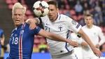 Finland's Kasper Hamalainen, right, vies for the ball with Iceland's Hordur Magnusson during their World Cup Group I qualifying soccer match in Tampere, Finland, Saturday, Sept. 2, 2017. (Jussi Nukari/Lehtikuva via AP)