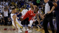 Houston Rockets' Chris Paul, right, steps over Golden State Warriors' Stephen Curry (30) after losing the ball out of bounds during the first quarter of an NBA basketball game Tuesday, Oct. 17, 2017, in Oakland, Calif. (AP Photo/Ben Margot)