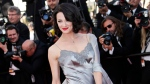 """FILE - In this May 26, 2013 file photo, actress Asia Argento arrives for the awards ceremony of the 66th international film festival, in Cannes, southern France. Italian Actress Asia Argento declares Harvey Weinstein the """"biggest serial predator in the history,"""" and says she has been """"doubly crucified"""", first by the sexual violence and second by the media in TV interview. She says the abuse when she was 21 """"smashed all my dreams and changed my perception of myself."""" (Photo by Joel Ryan/Invision/AP, File)"""