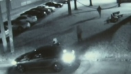 Surveillance footage shows two suspects running after a shooting in Lawrence Heights.