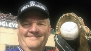This image provided by Keith Hupp shows Los Angeles Dodgers fan Keith Hupp holding the home run ball hit by Chicago Cubs' Javier Baez in the fifth inning of Game 4 of baseballs National League Championship Series at Wrigley Field in Chicago, Wednesday, Oct. 18, 2017. Remember that fan who made the great catch on Justin Turner's game-ending home run at Dodger Stadium over the weekend? Guess what? He did it again. Hupp came up with his second homer souvenir Wednesday night. (Keith Hupp via AP)