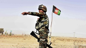 An Afghan National Army soldier directs a vehicle to stop at a checkpoint on the way to Zhari district, where the Maiwand army base is located, in Kandahar, Afghanistan, Thursday, Oct. 19, 2017. The Taliban have killed at least 58 Afghan security forces in a wave of attacks across the country, including an assault that nearly wiped out the Maiwand camp in the southern Kandahar province. (AP Photo/Massoud Hossaini)