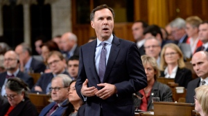 Minister of Finance Bill Morneau announces the government's economic update during Question Period on Parliament Hill, in Ottawa on Thursday, October 19, 2017. THE CANADIAN PRESS/Adrian Wyld