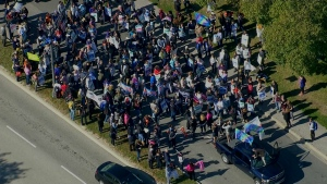 Students and faculty from Seneca College are seen on Keele Street during a rally demanding an end to the college faculty strike. (Chopper 24)
