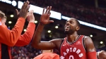 Toronto Raptors forward CJ Miles (0) is congratulated by teammates on the bench during second half NBA basketball action against the Chicago Bulls in Toronto on Thursday, October 19, 2017. THE CANADIAN PRESS/Frank Gunn