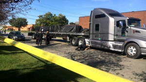 A transport truck involved in a fatal collision in Mississauga is shown at the scene. (CP24/Leena Latafat)