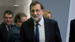 Spain's Prime Minister Mariano Rajoy leaves after a news conference at the Moncloa Palace in Madrid, Spain, Saturday, Oct. 21, 2017. The Spanish government moved to activate a previously untapped constitutional article Saturday so it can take control of Catalonia, illustrating its determination to derail the independence movement led by separatist politicians in the prosperous industrial region. (AP Photo/Paul White)