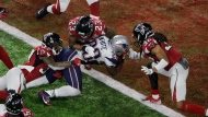 In this Feb. 5, 2017, file photo, New England Patriots' James White scores the winning touchdown during overtime of the NFL Super Bowl 51 football game against the Atlanta Falcons, in Houston. The Falcons and Patriots have lived in two different realities since their Super Bowl matchup in February. New England has savored the memories of how it turned a 25-point second-half deficit into largest comeback victory in Super Bowl history. Meanwhile, Atlanta has had to live through a constant stream of internet memes and endless jokes about the seemingly insurmountable lead it let slip away.(AP Photo/Charlie Riedel, File)