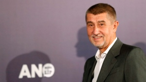 Czech billionaire and leader of ANO 2011 political movement Andrej Babis arrives to address the media, after most of the votes were counted in the parliamentary elections in Prague, Czech Republic, Saturday, Oct. 21, 2017. The centrist ANO movement led by populist billionaire Andrej Babis decisively won the Czech Republic's parliamentary election Saturday in a vote that shifted the country to the right and paved the way for the euroskeptic to lead the country. (AP Photo/Petr David Josek)