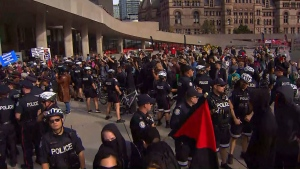 A line of police separate two groups of demonstrators at Nathan Phillips Square on Oct. 21, 2017. (CP24)
