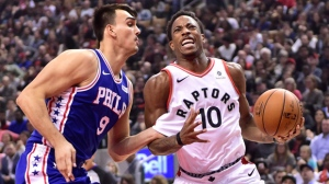 Toronto Raptors guard DeMar DeRozan (10) is fouled on his way to the net by Philadelphia 76ers forward Dario Saric (9) during first half NBA basketball action in Toronto on Saturday, October 21, 2017. THE CANADIAN PRESS/Frank Gunn