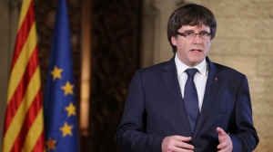 Catalan President Carles Puigdemont speaks during a statement at the Palau Generalitat in Barcelona, Spain, on Saturday, Oct. 21, 2017. The Spanish government announced an unprecedented plan Saturday to sack Catalonia's separatist leaders, install its own people in their place and call a new regional election, using previously untapped constitutional powers to take control of the prosperous region that is threatening to secede. (Ruben Moreno/Presidency Press Service, Pool Photo via AP)