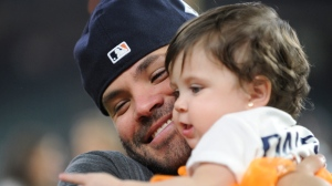 Houston Astros' Jose Altuve celebrates with his daughter Melanie after Game 7 of baseball's American League Championship Series against the New York Yankees Saturday, Oct. 21, 2017, in Houston. The Astros won 4-0 to win the series. (AP Photo/Eric Christian Smith)